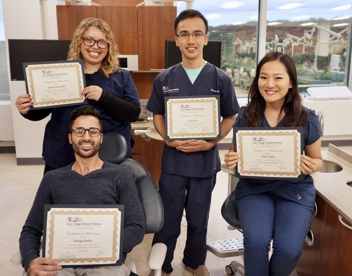 Participants of the research elective pose with their certificates. (Not pictured: Zev Kizelnik)